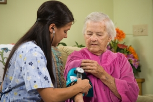 Care worker with elderly woman