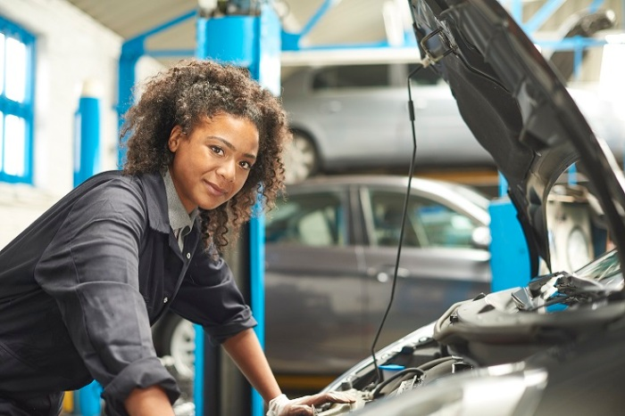 proud female auto mechanic